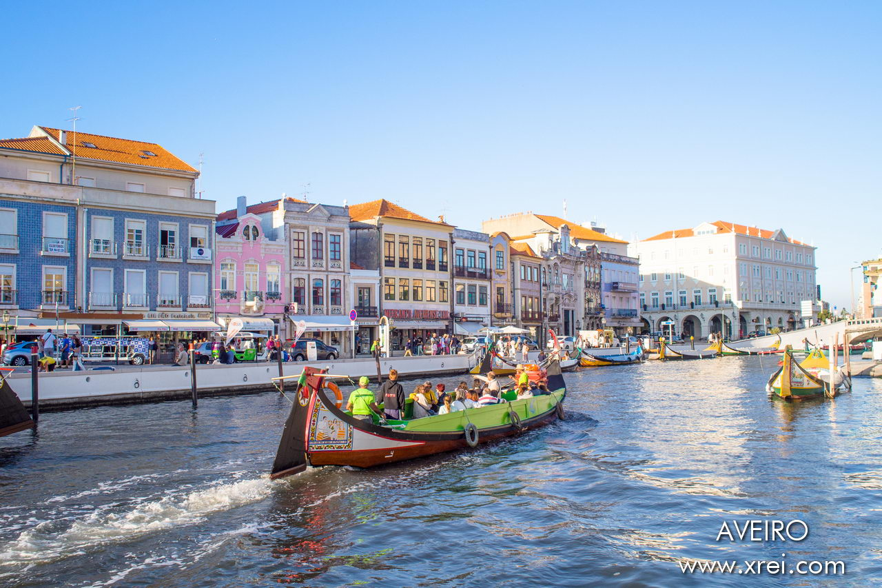 "Aveiro, known as ""The Venice of Portugal"" due to canals, bridges, and moliceiro boats..."