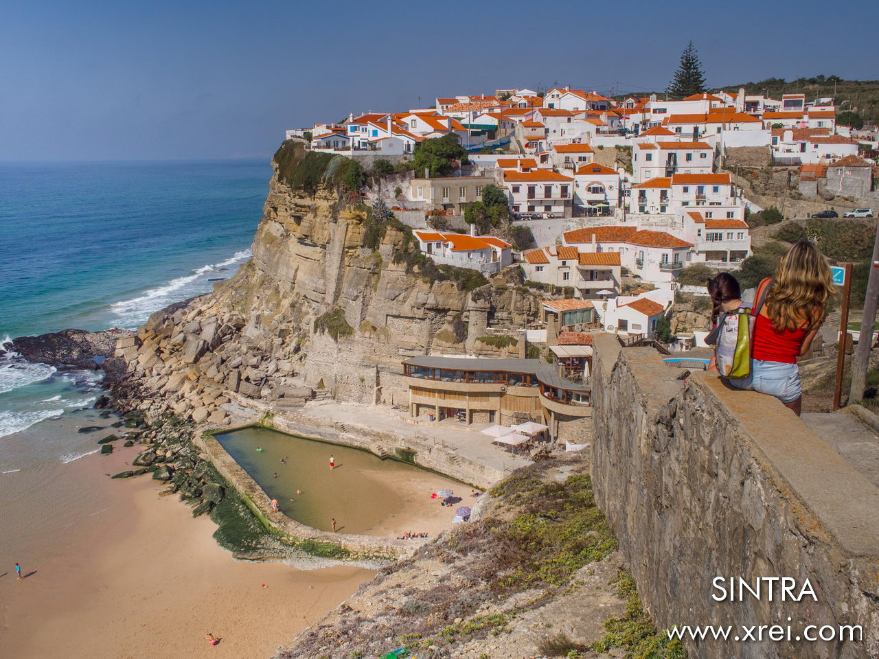 Azenhas do Mar is a village on the coast of the municipality of Sintra, parish of Colares. Azenhas do Mar is well known due to the beach where there is a natural ocean swimming pool, being one of the most photographed places for postcards in Portugal. The name Azenhas means Water Mill.
