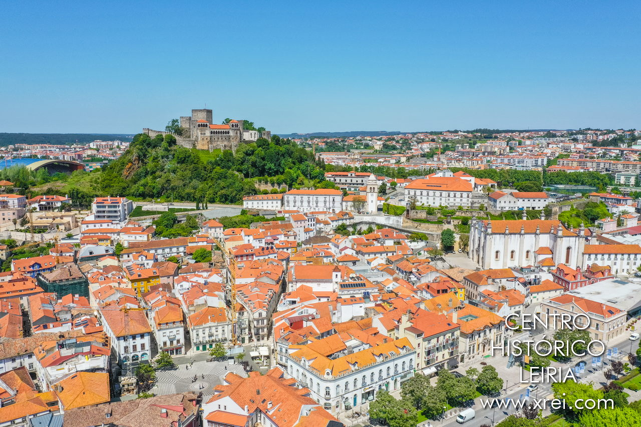 Historic center of the city of Leiria, with Rodrigues Lobo square, the historic buildings around, the cathedral of Leiria on the right, the municipal stadium of Leiria on the bottom on the left, and the castle at the top of the image