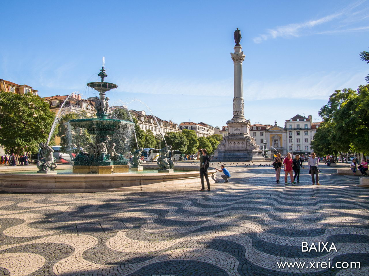Dom Pedro IV Square (Rossio) during the day, with a relaxed atmosphere