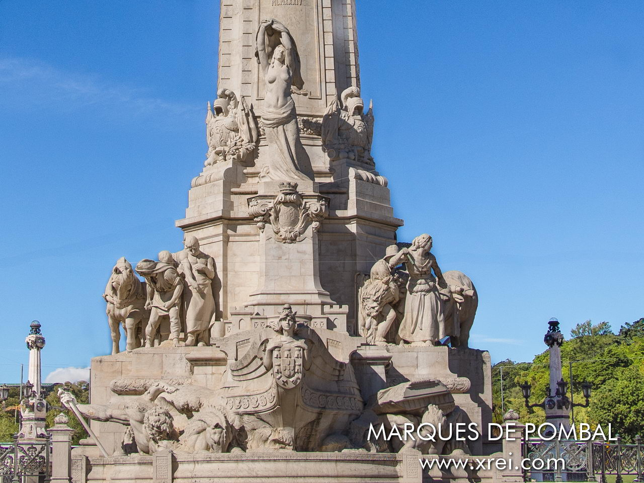 Statues at the base of the Marques de Pombal monument, with the naked woman symbolizing reconstructed Lisbon, together with the sculptures of Pluto and Poseidon symbolizing the improvements to Lisbon made by Marques de Pombal. The bow of the Nau symbolizing the renewal of the merchant navy. Sculptural group on the right side representing agriculture, the Nets on the left side representing fishing.