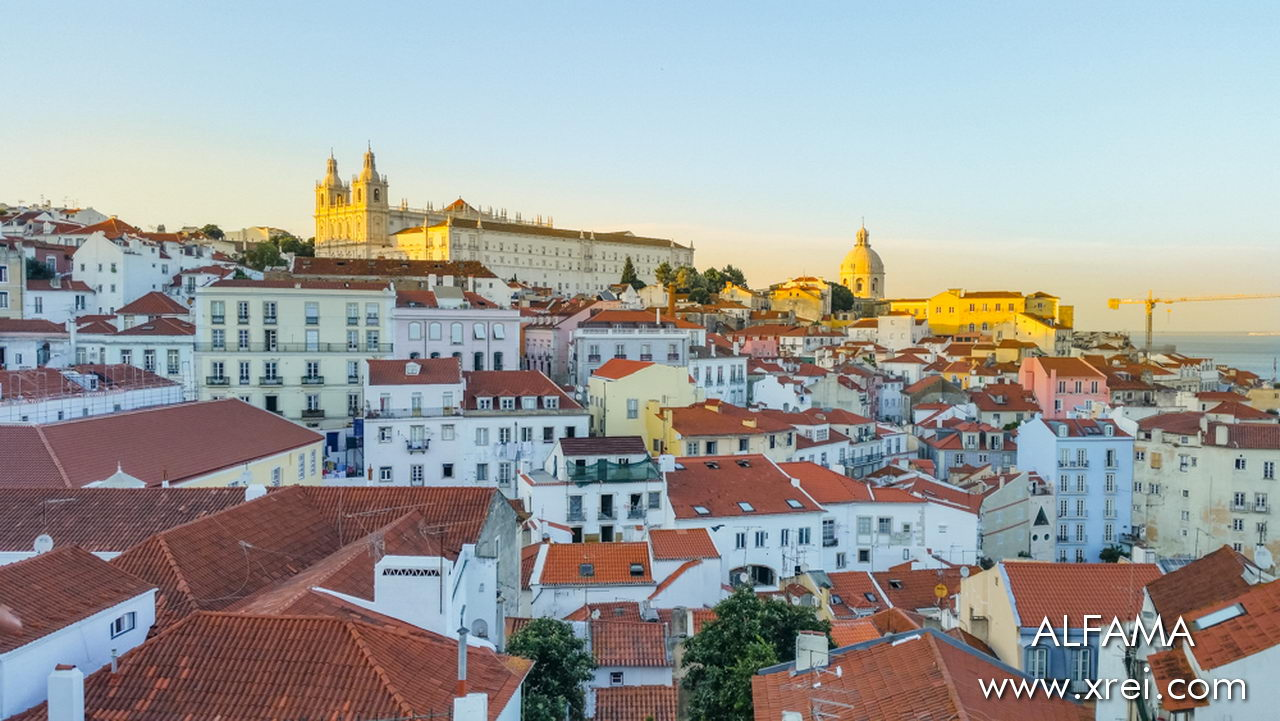 Roofs of houses in Alfama with views of the church and the pantheon on the horizon